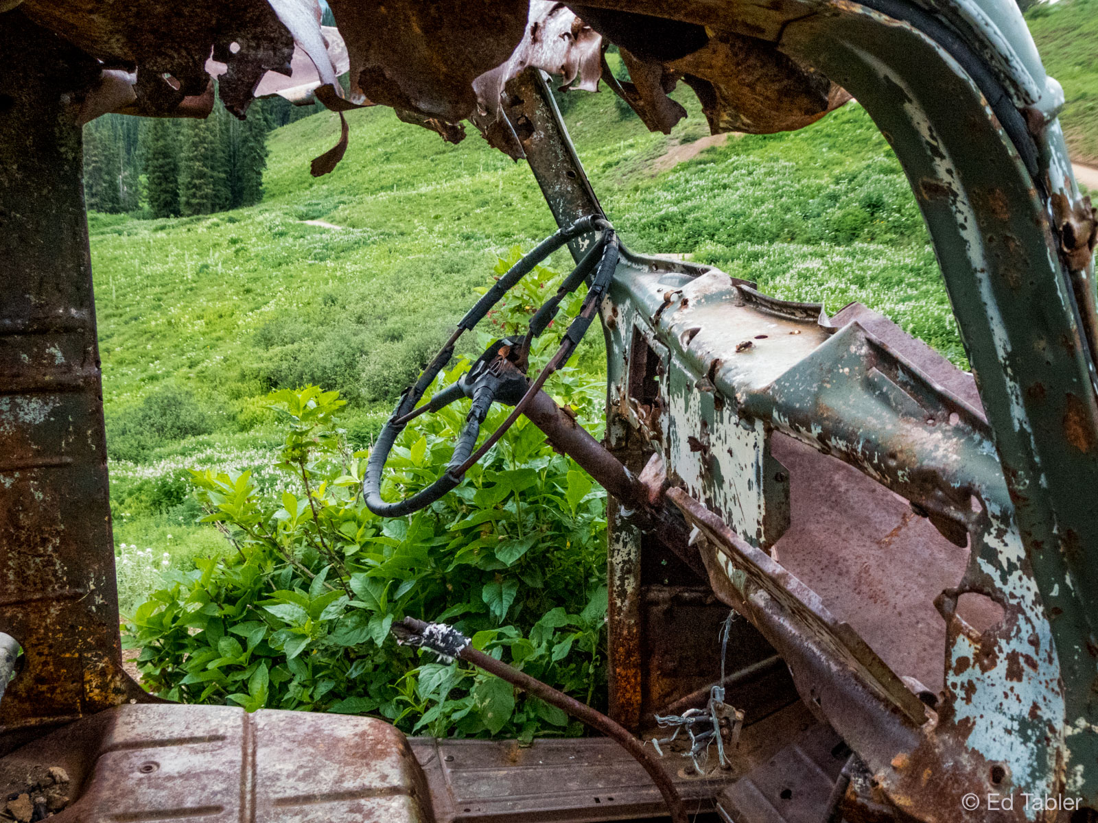 Only the skeleton remains of aniconic oldpick-up truck parkedatElkton Mine near Crested Butte.&...
